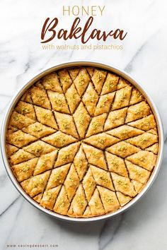 A round baking pan filled with honey soaked baklava with pistachios cut into a diamond pattern. Greek Desserts, Köstliche Desserts, Greek Recipes, Desert Recipes, Delicious Desserts, Yummy Food, Desserts With Honey, Greek Sweets, Health Desserts