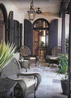 Grey flagstone floor, French doors with grey shutters and grey rattan furniture. - Grey flagstone floor, French doors with grey shutters and grey rattan furniture. Just lovely. Grey Rattan Furniture, Wicker Chairs, Porch Chairs, Cane Furniture, French Furniture, Outdoor Rooms, Outdoor Living, Outdoor Patios, Outdoor Kitchens