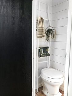 The walls of the bathroom were painted white. Tagged: Bath Room and One Piece Toilet. Photo 14 of 16 in Hit the Road With This Chic Camper on Sale For $28K