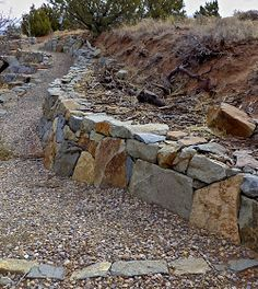 In the last post I did for this series on tips for building a dry stack stone wall I showed how I go about building a dry stack wa. Gabion Stone, Stone Retaining Wall, Stone Masonry, Retaining Walls, Dry Stack Stone, Stacked Stone Walls, Dry Stone, Privacy Fence Landscaping, Landscaping With Rocks
