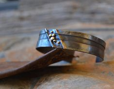 rustic foldformed oxidized copper cuff bracelet with sterling silver accents by Studio Luna Verde