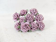 Mulberry paper rose. It will work great to use it as a nice touch for your bouquet or as a filler for your handmade flower crown, scrapbooking, gift box packaging, wedding decoration. QUANTITY: 10 individual flowers FLOWER HEAD SIZE: 2 cm or 20mm MATERIAL: Mulberry paper, wire as stem