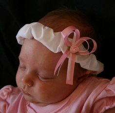 All cotton headbands soft and sweet for baby Princesses precious head.   The elastic is inside the fabric so it should not leave marks on baby's head. Pink Satin Bow with a Pink Satin Rose.  Carlykins Boutique Baby Girl Pink Satin Rose by CarlykinsBoutique, $5.25