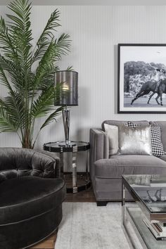 Living | Iconic: Less pattern, more solids, less black, more grey, tidy and sleek accessorising for still clean, masculine and sophisticated, but calmer Iconic living room.