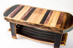 This Fallen Oak Coffee Table is entirely handmade from repurposed wine barrels sourced from Napa and surrounding wine regions. Each table is a unique, functional piece of art! The inside and outside of the wine barrel heads are used to create beautiful contrast on the table top. The table top also features an authentic cooperage marking in the center and is accented with barrel hoop ends. The functional shelf below is made of full wine barrel staves that add more wine infused color. This…