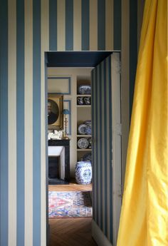 10 Fabulous Variations on a Striped Room - Thou Swell - Blue striped walls with yellow curtain and jib door via World of Interiors on Thou Swell # - Decor, Striped Room, Home Decor Inspiration, World Of Interiors, Blue Striped Walls, House Interior, Yellow Curtains, Interior Design, Striped Walls