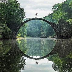 The Devil's Bridge in Kromlau Park, Germany, was designed to reflect a perfect circle in the water