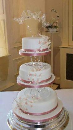 Butterfly cascade wedding cake in pale pinks