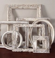 Custom painted set of seven frames, cottage chic antiqued frames, shabby chic open backed frames by MandyisEachOneUnique on Etsy https://www.etsy.com/listing/179619738/custom-painted-set-of-seven-frames