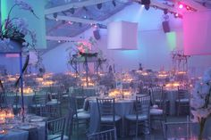 These white lanterns made from fabric and 2x4s were suspended from the tent ceiling and then lit with colored lights.