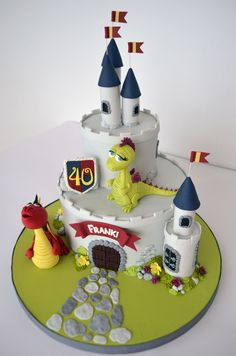 Boy castle birthday cake with dragons