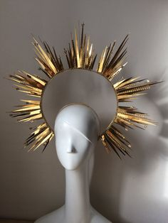 A shining gold halo headdress, made with gold chrome plastic, on a metal wire frame. Scattered with Swarovski crystals and crystal chains. Truly a dazzling, breath taking piece. The headdress has 3 combs, which hold it steady on the head. I takes 2 weeks to prepare this piece. Please note that the small gold crown is a separate listing, you can find it in our store as the Dress Crown, the crystal stones can be made red as on the picture. All of our hair jewely is handmade in St. Petersburg…