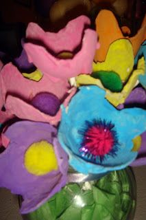 Egg Carton Flowers- review: A super easy teacher appreciation gift!  We used a button and threaded the pipe cleaner through the holes. Added a little glue to the bottom of the button just in case.