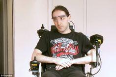 A Man Wears Gear for Steering His Wheelchair by Ear