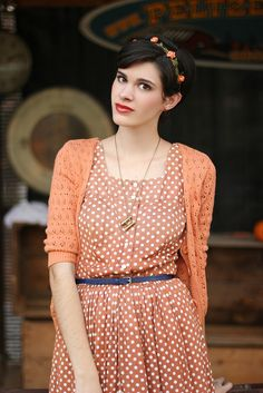 Polka dot dress + cardigan + belt + headband.