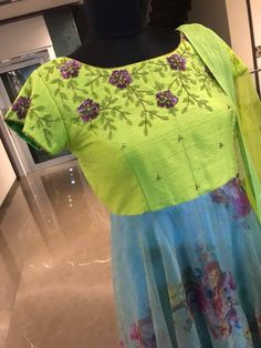 Beautiful parrot green and ice blue color combination floor length dress with floral design hand embroidery thread work on yoke. Ready to ship Price : 8500 INRTo order whatsapp 7013728388 25 September 2018 Kids Blouse Designs, Hand Work Blouse Design, Stylish Blouse Design, Dress Neck Designs, Bridal Blouse Designs, Chudidhar Designs, Party Wear Maxi Dresses, Long Gown Dress, Long Frock