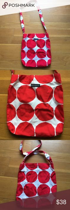 Marimekko Red and White Dot Bag  Cotton/ canvas red and white large dot print Marimekko bag. Long strap and has a magnetic snap closure. Inner pocket with zipper. Excellent condition with no discoloration. Can be worn messenger style or cross body. Marimekko Bags