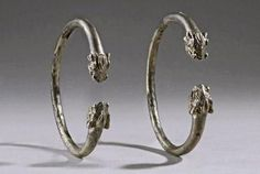 Anatolian Pair Of Silver Bracelets With Dragons' (perhaps boars'?) Heads | 1600 BCE - 1200 BCE.  Urartu was a kingdom on the shores of Lake Van in what is now modern day Armenia. It rose to prominence in the 9th century B.C.E., and was powerful in Asia Minor until the neighboring Medes conquered in the 6th century BCE. At the height of its power, it extended its influence as far north as the Black Sea and as far south as Mesopotamia.