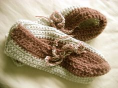 Crocheted slippers using this pattern: http://www.garnstudio.com/lang/en/pattern.php?id=6339&lang=en#pattern_content