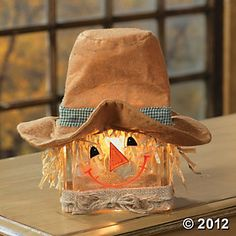 At last: a way to use that adorable funky hat you found at the thrift or consignment shop! Scarecrow Glass Block Lamp. Click to go to the site... there's also a snowman version!