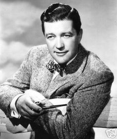 Dennis Morgan. His hair is so perfectly coiffed. But the bow tie, jacket, pipe combo is fantastic! - Luckypinup.com