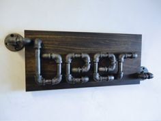 The Rampant A one of a kind design by Mobee Industrial Designs. An Industrial Black Pipe Beer Sign! A great addition to any Man Cave! Pipe Furniture, Industrial Furniture, Industrial Pipe, Industrial Design, Industrial Shelving, Pipe Decor, Beton Design, Do It Yourself Furniture, Black Pipe