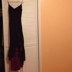 Bcbgmaxazria dress Beautiful dress with ruffle slit on the left side. Burgundy and hot pink in the inside showing through the bottom.NWOT. I don't see size but believe it is small or xsmall BCBGMaxAzria Dresses