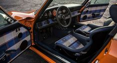 Popping against the understated navy blue leather are 'Tyler Tartan' accents, which combine four shades of blue with two shades of orange and a cream. We must commend the car's owner, who commissioned this wonderful car –it's shot straight to the top of our list of favourite Singers. We're wondering how a car can look so '1970s' yet so crisp and modern at the same time? Bravo, Singer.