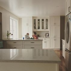 White shaker cabinets Caesarstone Bianco Drift counters quadLevel side split house Lee Valley hardware Kitchen Pantry Design, Kitchen Redo, Kitchen Ideas, Beach House Kitchens, Home Kitchens, Gray Quartz Countertops, White Shaker Cabinets, Kitchen Utilities, Hardware