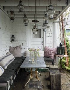 A covered brick patio serves as an outdoor dining area at designer John Derian's Provincetown, Massachusetts house. Photograph by Matthew Williams for Gardenista. For more of this project, see our new book, Gardenista: TheDefinitive Guide to Stylish Outdoor Spaces.