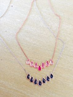 Blue sapphire and ombre pink sapphire pear shape necklaces. www.beamillen.com