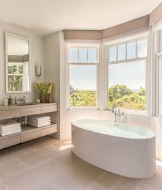 The bay window in this master bathroom offers 180-degree views of Cape Cod as well as plenty of natural light | archdigest.com