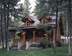 Jack Hanna's log cabin in Montana. Via Hooked On Houses.
