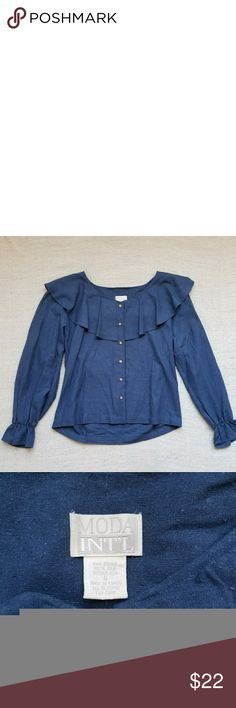 Vintage Blue Ruffle Top Fun and flirty vintage statement piece! Blue with cream buttons. Ruffled neck and clinched sleeves so they have some volume as well. Says size 8. In general it's a bout a size medium or large. No stains or rips. In good vintage condition. Vintage Tops Blouses