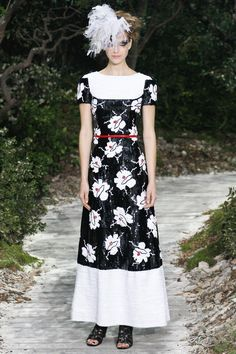 Chanel-Love the camellia pattern with the blocking of the dress.