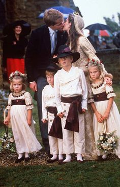 The Wedding of Charles Spencer and Victoria Lockwood. The two children at far left are Laura Fellowes and Prince Harry, the children of Charles' sisters Jane and Princess Diana. The wedding gown and children's outfits are copies of those worn in a painting of a Spencer wedding at Althorp. Victoria chose to replicate the painting at her wedding.