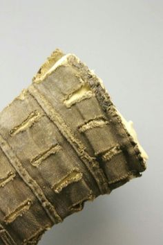 Lower sleeve of slashed linen  Detail of the top of the sleeve, and showing the strips of fabric sewn down between the rows of slashes.  Das Ärmelstück Ende 15./16. Jahrhundert Allgäu-Museum Diakonisches Werk, Kempten (Stadtarcheologie, Fd. Nr. 16261) Photo by Marion McNealy