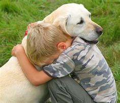 Awwwww....a little boy's best friend !