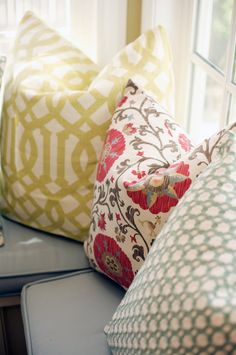 I like mixing patterns for pillows. These aren't my absolute favorites, but I do love this palette in general - neutrals with color poppers.