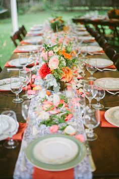 Lace Table Runners + Low Centerpieces + Lots of Colorful Rose Petals - Very Romantic! See more of the wedding on SMP: http://www.StyleMePretty.com/2014/03/04/coral-wedding-at-mountain-magnolia-inn/ D'Arcy Benincosa Photography