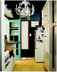 Painting walls and ceilings the same dark color blurs spatial lines and makes a small kitchen seem bigger | domino.com