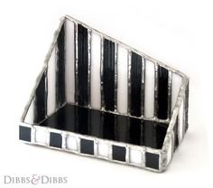 The Business - This intricately pieced together and very unique business card holder is the perfect way to keep your cards displayed on your desk at home or at work. It can also be used as a trinket box to keep rings, keys etc in. Inspired by the style of creatives such as Tim Burton. http://www.dibbsanddibbs.com/collections/handmade-stained-glass-and-wooden-decorations/products/the-business