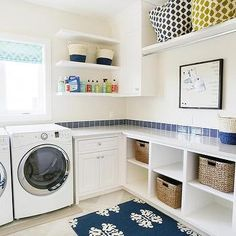 White and Blue Laundry Room with Cubbies Filled with Baskets