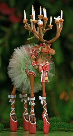 Dash Away Dancer from Dept. 56  -  She became part of our Christmas house a couple of years ago.  So cute.