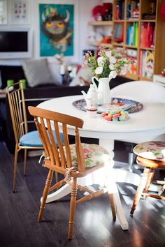 """Sneak Peak: Eleonore Bridge. """"I bought a bunch of mismatched chairs at Emmaus [Goodwill]. I like these small differences. It becomes graphic, and I like this kind of """"happy accident"""" in my home."""" #sneakpeek"""
