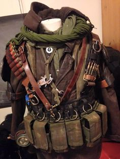 The look of this design shows that during this post apocalyptic time, people would be scavenging for parts in order to survive. The dark colours also represents the post apocalyptic time. Post Apocalyptic Clothing, Post Apocalyptic Costume, Post Apocalyptic Fashion, Post Apocalypse, Apocalypse Survival, Zombie Apocalypse Weapons, Apocalypse Costume, Apocalypse Fashion, Survival Clothing