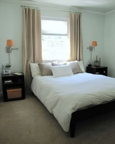 Window above bed tip - get a curtain rod the length of the bed, not the window