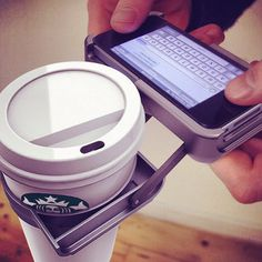 UpperCup  An iPhone cup holder...so you can text on your iPhone while drinking your cup of coffee!