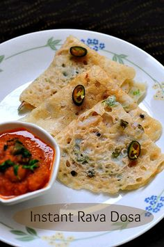 Quick Instant Rava Dosa - Onion Rava Dosa Recipe (Step by Step)   GREDIENTS: 1 cup of rava or semolina 1/2 cup of rice flour 1/4 cup of onion, finely chopped 2 tbsp of coriander leaves (cilantro), finely chopped 1 tsp of grated ginger 1/2 tsp of whole black pepper 3-4 tsp of ghee or oil, for cooking 1 green chilli, chopped fine