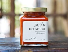 Jojo's Sriracha >> Small-batch chili sauce created by Joelene Collins. Her particular take on the classic Thai table staple is made from a variety of locally sourced peppers, distilled vinegar, garlic and organic palm sugar — and no two batches are exactly alike. Despite the variation, her current blends will challenge your loyalty to mainstream brands.